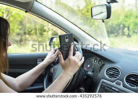 image depicting a woman riding in a car and talking on the phone