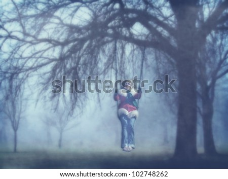 image from nature background texture series (girl swinging from a tree)