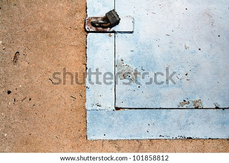 image from stone and metal texture background series (metal trap door with lock and hasp in concrete sidewalk)