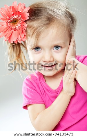 Image litlle girl with a flower on a white background - stock photo