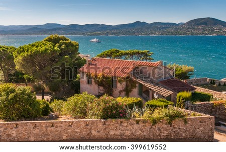 Image made with a sublime place of St Tropez, where the red roofs of the houses and the azure shore away from the horizon of the mountains. - stock photo