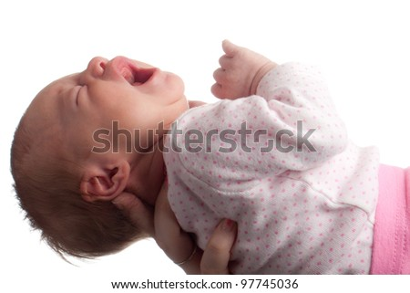 Image of a baby being held in the air. - stock photo