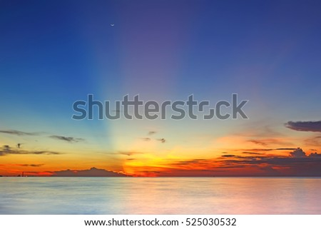 Image of a beautiful sunrise over sea, heavenly light