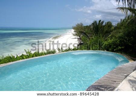 Image of a beautiful swimming-pool in resort - stock photo