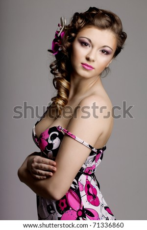 Image of a beautiful woman with a wonderful luxury makeup and hairstyle - stock photo