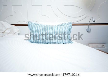 image of a bed with pillow in the hotel room - stock photo