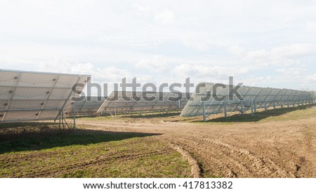 image of a big solar plant in fog - stock photo