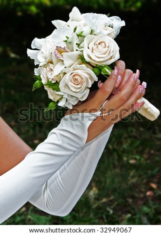 Image of a bridal bouquet in brides hands