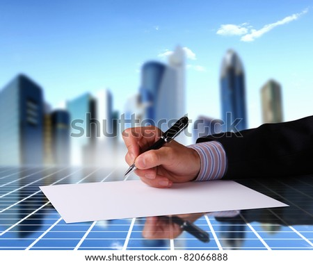 Image of a businessman hand signing documents - stock photo