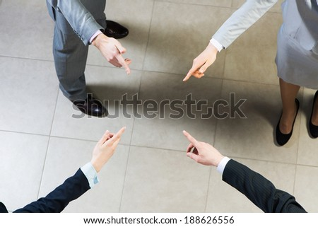 image of a businessman hands pointing to each other