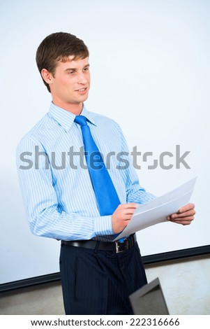 image of a businessman in the office with business papers