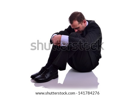 Image of a businessman looking depressed. Isolated on white