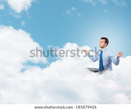 image of a businessman meditating on the clouds - stock photo