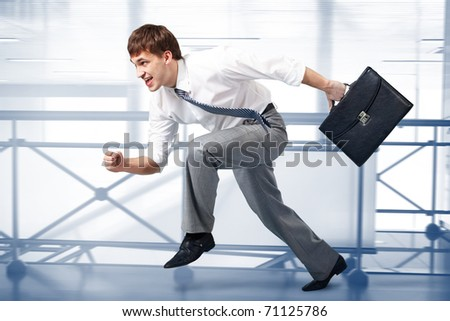 Image of a businessman racing in office building - stock photo