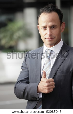 Image of a businessman showing a thumbsup gesture