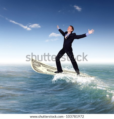 Image of a businessman surfing on the sea waves - stock photo