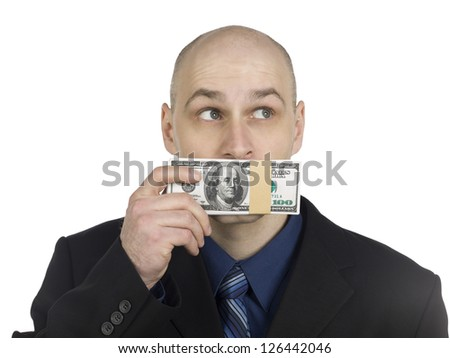 Image of a businessman with a bunch of money covering his mouth isolated on a white background - stock photo
