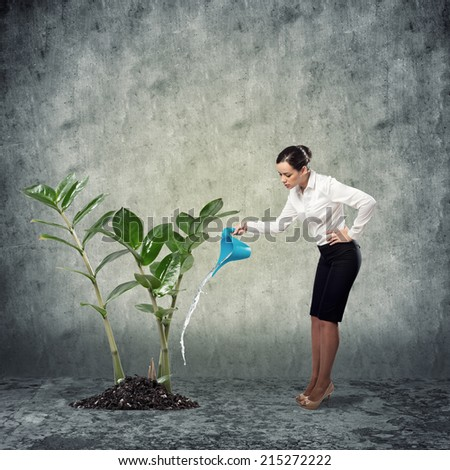 image of a businessman with a watering can