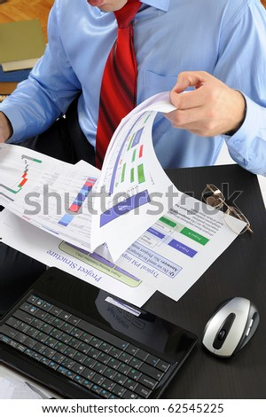 Image of a businessman working with documents in the office of the table - stock photo