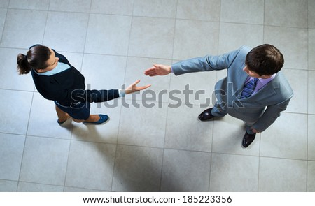 image of a businessmen stretching out their hands towards each other, the future handshake