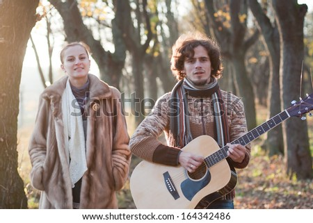 Image of a couple walking in the park. - stock photo