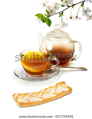image of a cup, teapot with tea and sweets closeup  - stock photo