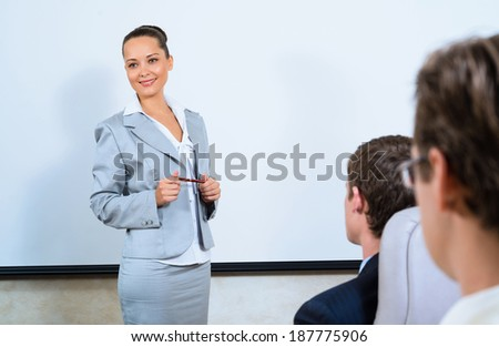 image of a discusses business woman with colleagues - stock photo