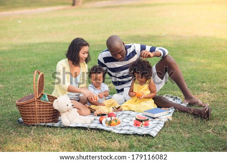 Image of a family having picnic outdoors - stock photo
