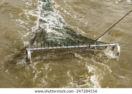 image of a fishing net in action in the north sea - stock photo