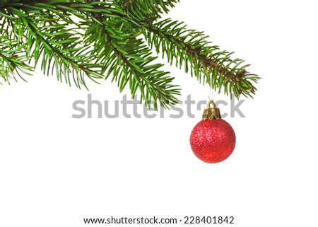 Image of a fresh spruce branch decorated with a glittery christmas bauble - stock photo