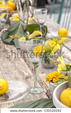 Image of a garden table set for a meal - stock photo
