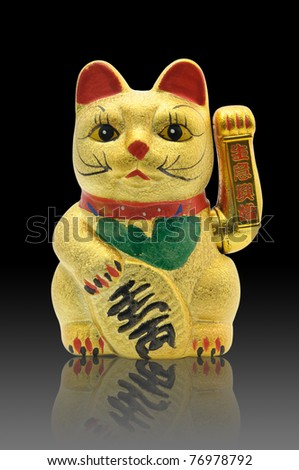 Image of a golden  lucky cat on black space
