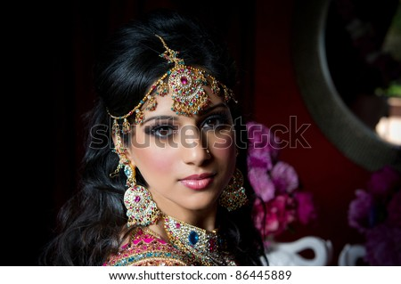 Image of a gorgeous Indian bride traditionally dressed - stock photo