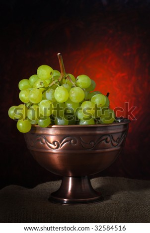 Image of a grape with limited light and abstract background