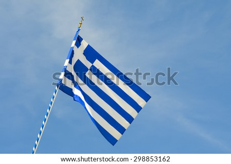 Image of a Greece flag with blue sky - stock photo