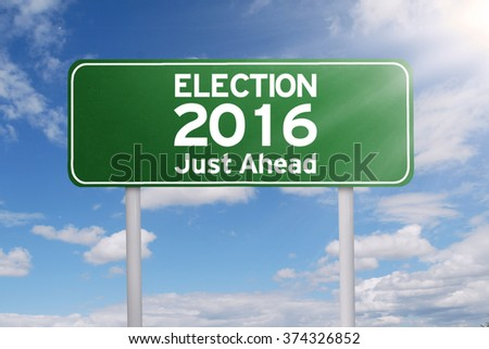 Image of a green signpost with a text of election 2016 just ahead under cloudy sky - stock photo