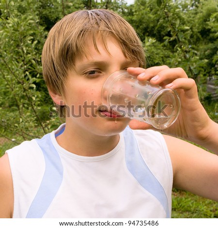 Image of a guy drinking water from a glass - stock photo