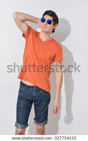 image of a handsome young man in sunglasses shot in studio - stock photo