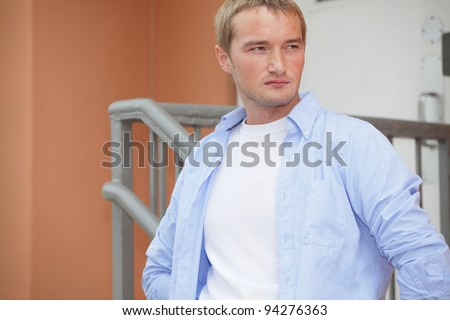 Image of a handsome young Russian model glancing sideways - stock photo