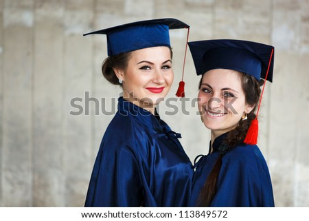 Image of a happy young graduates - outdoor shot - stock photo