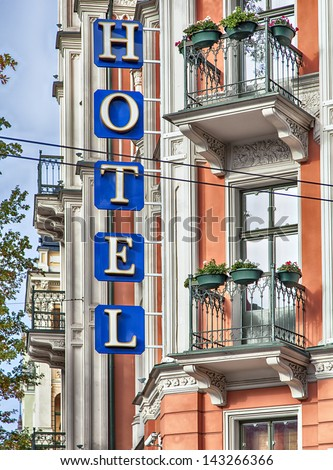 Image of a hotel sign on a traditional old building - stock photo