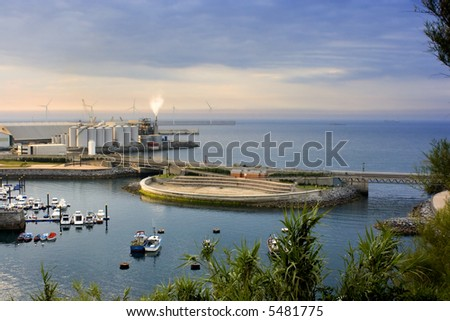 image of a industry near the dock in the sea - stock photo