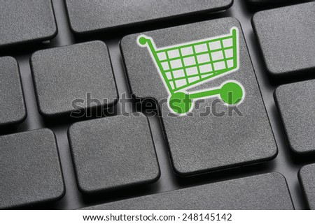 Image of a keyboard with a green shopping cart on the Enter button - stock photo