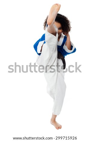 Image of a little girl practice karate over white - stock photo