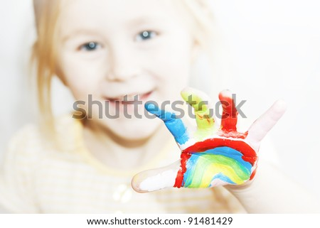 image of a little girl with hands painted - stock photo