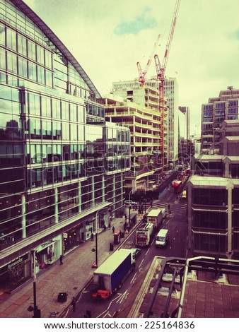 Image of a London street taken from a high vantage point on a mobile phone camera with Instagram filter applied  - stock photo