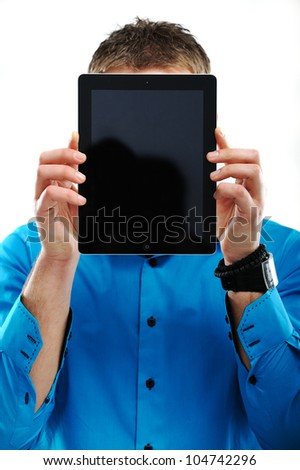 Image of a man covering his face with tablet computer - stock photo