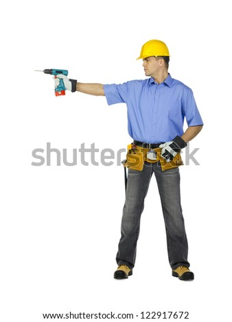 Image of a manual construction worker wearing tool belt, hard hat and holding drill machine.