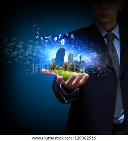 Image of a modern cityscape in the hand of a businessman
