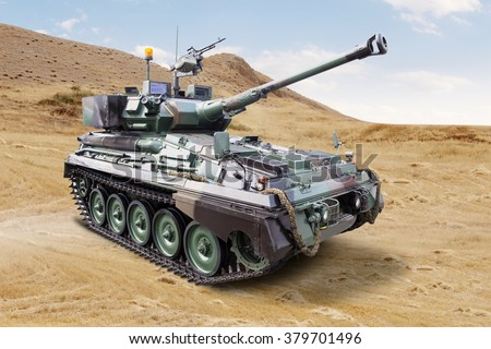 Image of a modern military tank with cannon on the field - stock photo